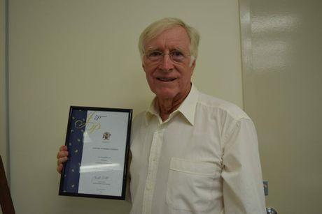 Edward Egerton displays his 50 years of service award.