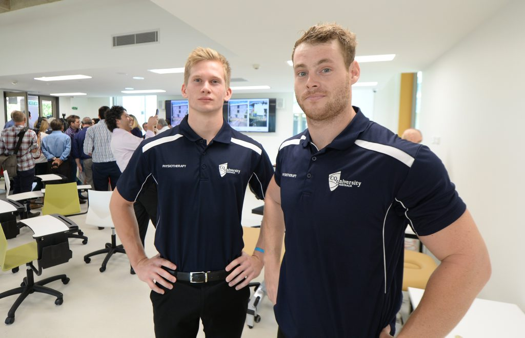 CQ University students Travis Atkinson and Russell Cunningham during Prime Minister Turnbull's tour of the university's new Allied Health building. Photo: Chris Ison / The Morning Bulletin