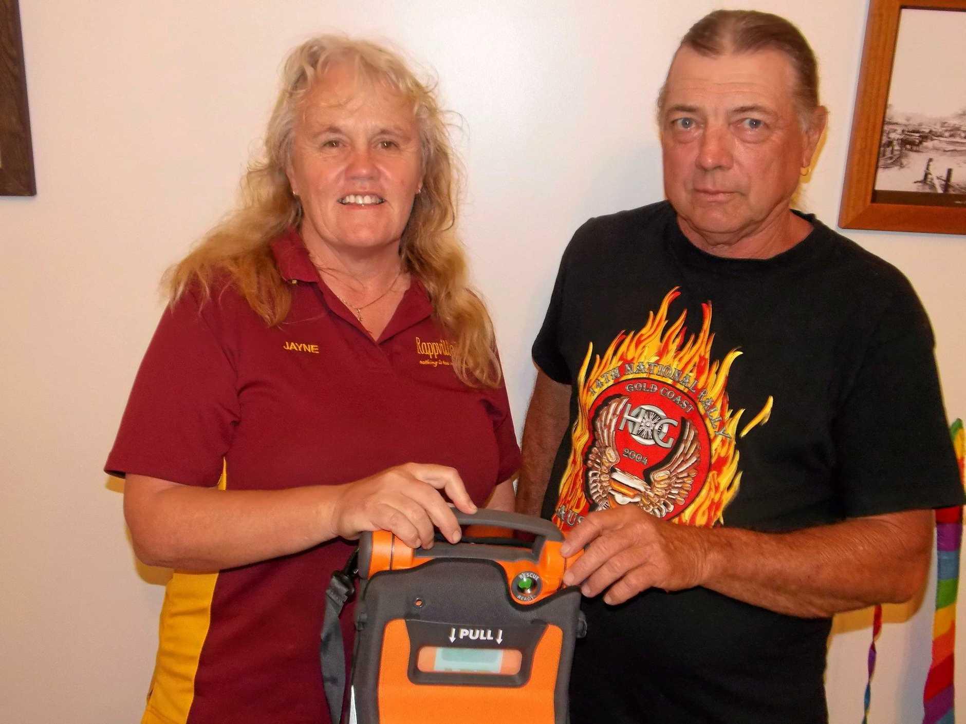 Rappville publican Jane Fitzpatrick with Social Club President Steve Bennett and defibrullator.