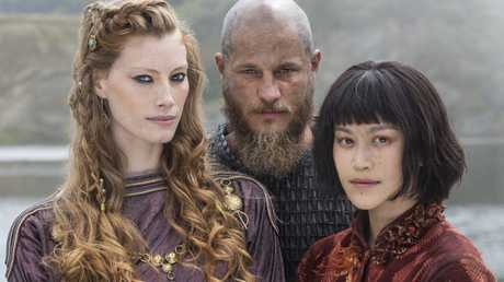 Alyssa Sutherland, Travis Fimmel and Dianne Doan star in season four of Vikings.