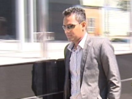Sheran Fernando leaves the court during the trial.