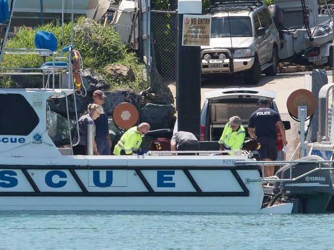 Police arrive back to shore with the recovered body Photo: Contributed