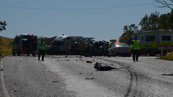 Two passengers of a sedan are in critical condition after their car collided with two trucks, one (pictured) which cantilevered blocking the Cunningham Hwy at Sandy Creek Rd yesterday afternoon.