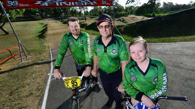 TRACKSIDE TRIO: Three generations involved with the Ipswich BMX Club (from left) Lee Smith (president), Peter Smith (berm steward) and Alissa Smith (11).