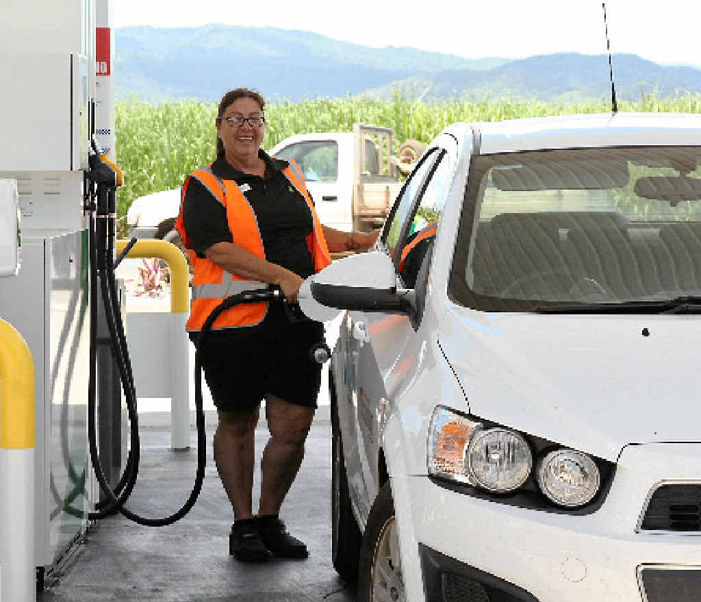 BACK OPEN: Margaret Maher tests out the new pumps at the BP servo on the Bruce Hwy.