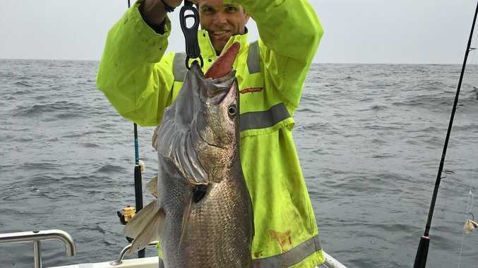 Luke Makings with a 14kg jewfish he caught while on a Reeltime Charters Fishing Trip.