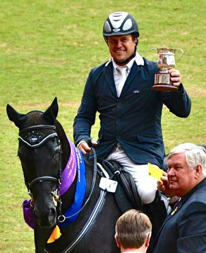 Cooroy's Billy Raymont won a top show jumping class at the Sydney Royal Easter Show on forteen-year-old black thoroughbred Stardom.