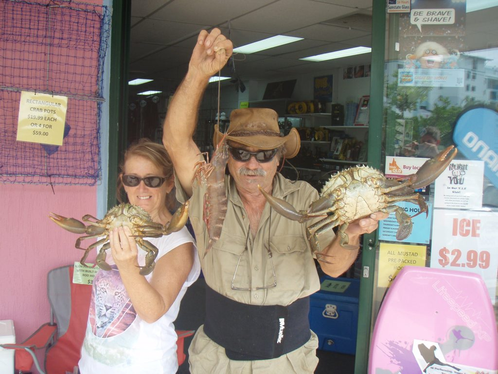 WHAT BEAUTIES: Captain Sandbank (Ross Stark) with his wife Julie, pictured with a feed of buck crabs and a giant leader prawn.