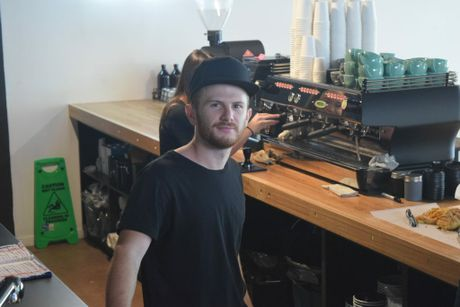 PROUD AS PUNCH: Owner of Nambour's newest espresso bar Ty Chapman prepares for a busy opening day.
