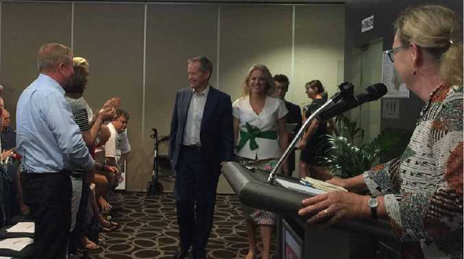 LEADER ARRIVES: Federal Opposition Leader Bill Shorten is welcomed at last night's forum at Souths Leagues Club.