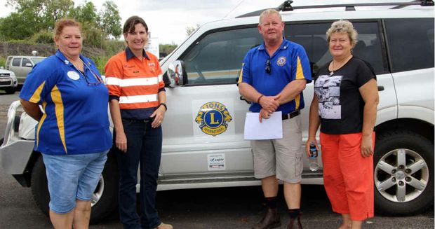 DONATION: Minerva Mine hands over keys of a Pajero to the Springsure Lions group. Pictured (from left) are Lion and Zone 13 chairwoman Suzanne Aschoff-McKay, mine representitive Doris Prewitt, Lions president John Noffke and Springsure Christian Family Church Pastor Glenys Ryan.