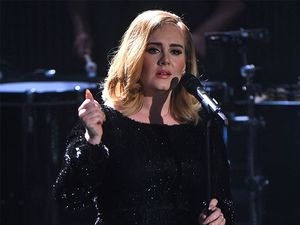 Adele vows to stop swearing - almost succeeds