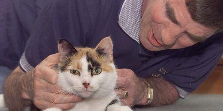 Globetrotting Port Taranki cat Colin's was accompanied home by employee Gordon MacPherson.