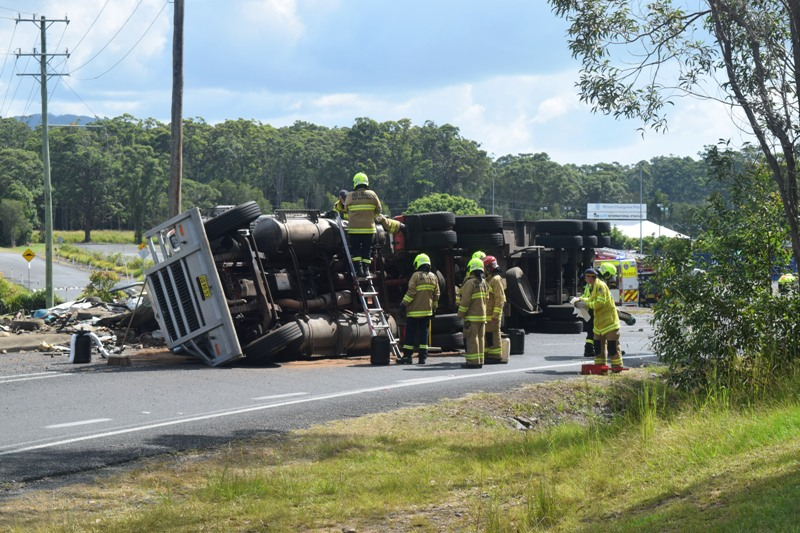 Stadium Dr is closed in Coffs Harbour after a truck carting scrap metal rolled around 10am.