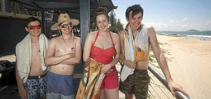 FANS OF THE PLAN: Visitors Liam Wrigley, David Austin, Jaime Cubit and Michael Hunter check out Mooloolaba Beach.