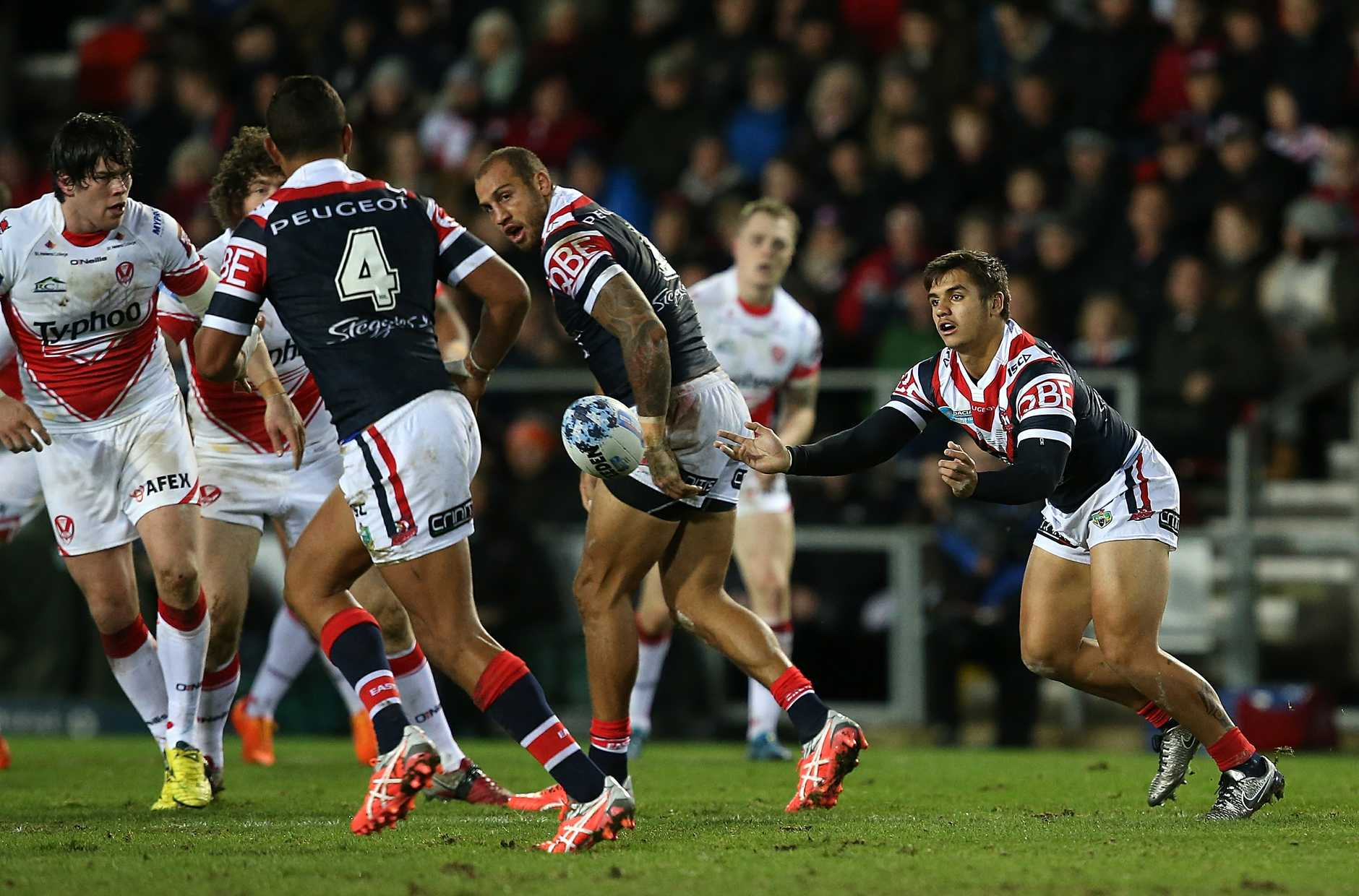 Jayden Nikorima passes during the Sydney Roosters clash with St Helens. Photo: Getty Images.