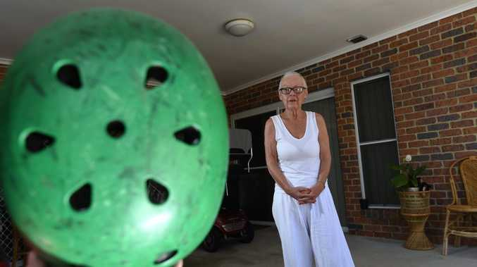 Marlene Burgess is reminding kids to wear a helmet after her grandson was knocked down by a car. Photo Marc Stapelberg / The Northern Star