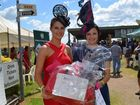 Jordan Edmonds from Brisbane with Fashion on the Fields best dressed female winner Dannielle Atkinson from the Sunshine Coast at the St Mary's Race Day at Allman Park.