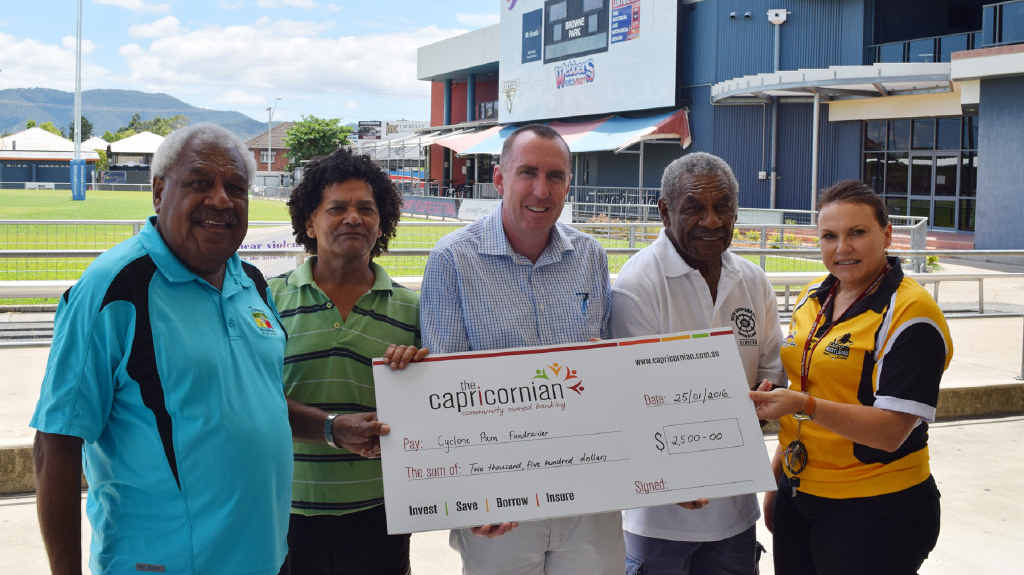 WELCOME DONATION: Russell Vea Vea, Glen Tataw, Rockhampton and District Junior Rugby League media officer Michael Fletcher, Tunna Vea Vea and RDJRL secretary Trudy Baker discuss how the funds raised will be used to help the recovery effort in Vanuata.