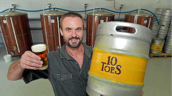 AT LAST: Co-owner of 10 Toes Brewery Rupert Hall enjoys a fresh pour from his first commercial batch, 10 years after he started brewing.