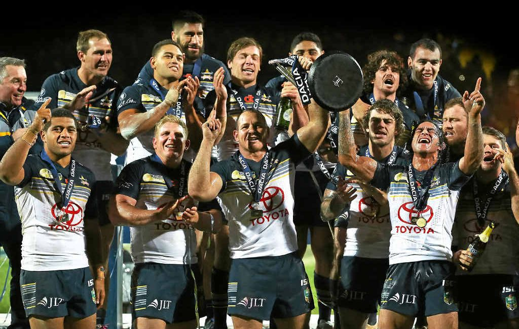 THE ICING: Johnathan Thurston and Matt Scott lift the World Club Challenge trophy as the North Queensland Cowboys celebrate victory over Leeds Rhinos at Headingley yesterday.