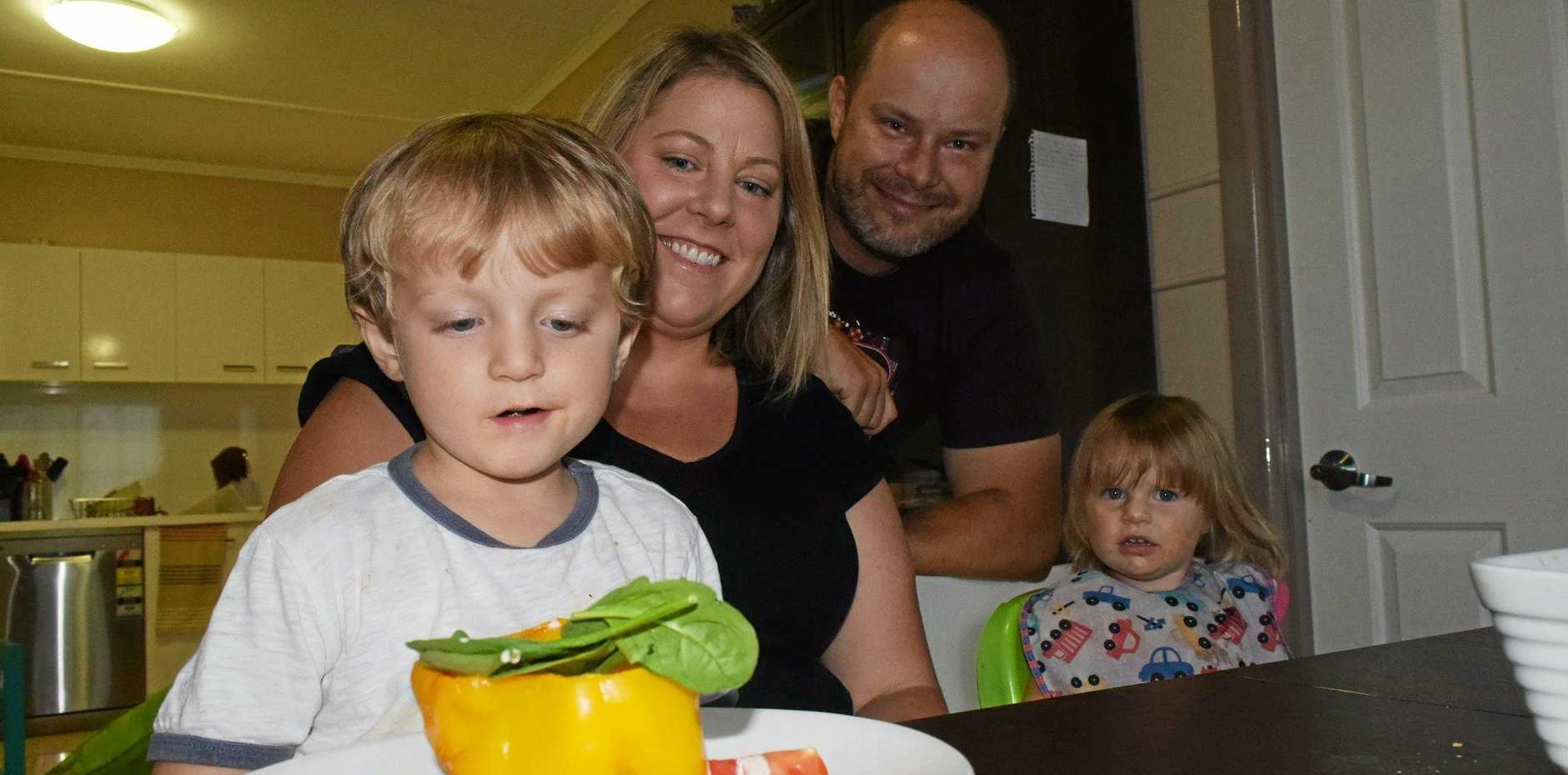 HAPPY FAMILY: Roma's Tracey Biehn and her family eat at the dinner table every night, but most families are not like this.