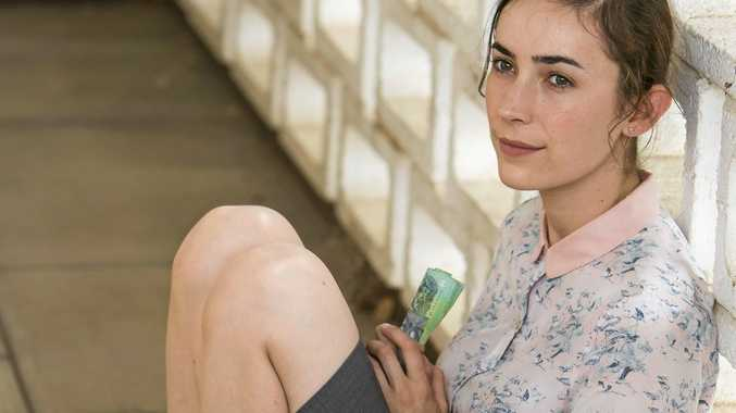 WELCOME IN WARWICK: Wanted star Geraldine Hakewill in a scene filmed at the Warwick Railway Station.