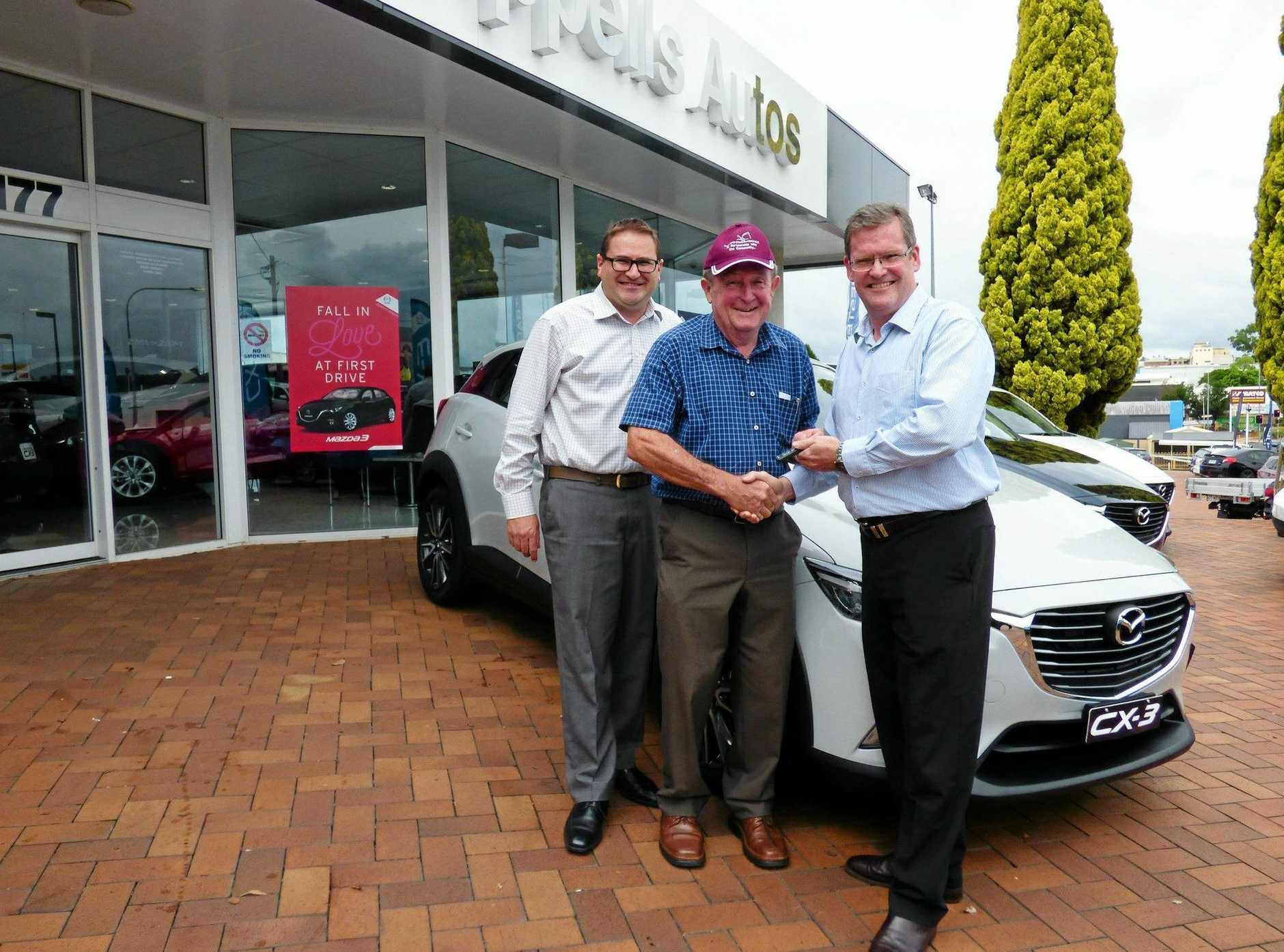 Wippells Autos dealer principal David Russell (left), Toowoomba Hospice chairman Graham Barron and Member for Toowoomba South John McVeigh MP check out the Hospice's new car thanks to a $25,000 grant.