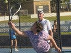 Janet Irwin hits a serve under the eyes of her coach Phil Beckman at Hotshots tennis at the Grafton Tennis Courts.