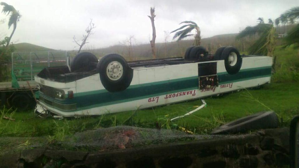 An overturned bus in Fiji.