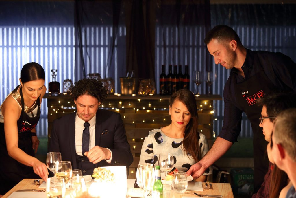 My Kitchen Rules contestants Lauren and Carmine serve their entree to judges Colin Fassnidge and Rachel Khoo.