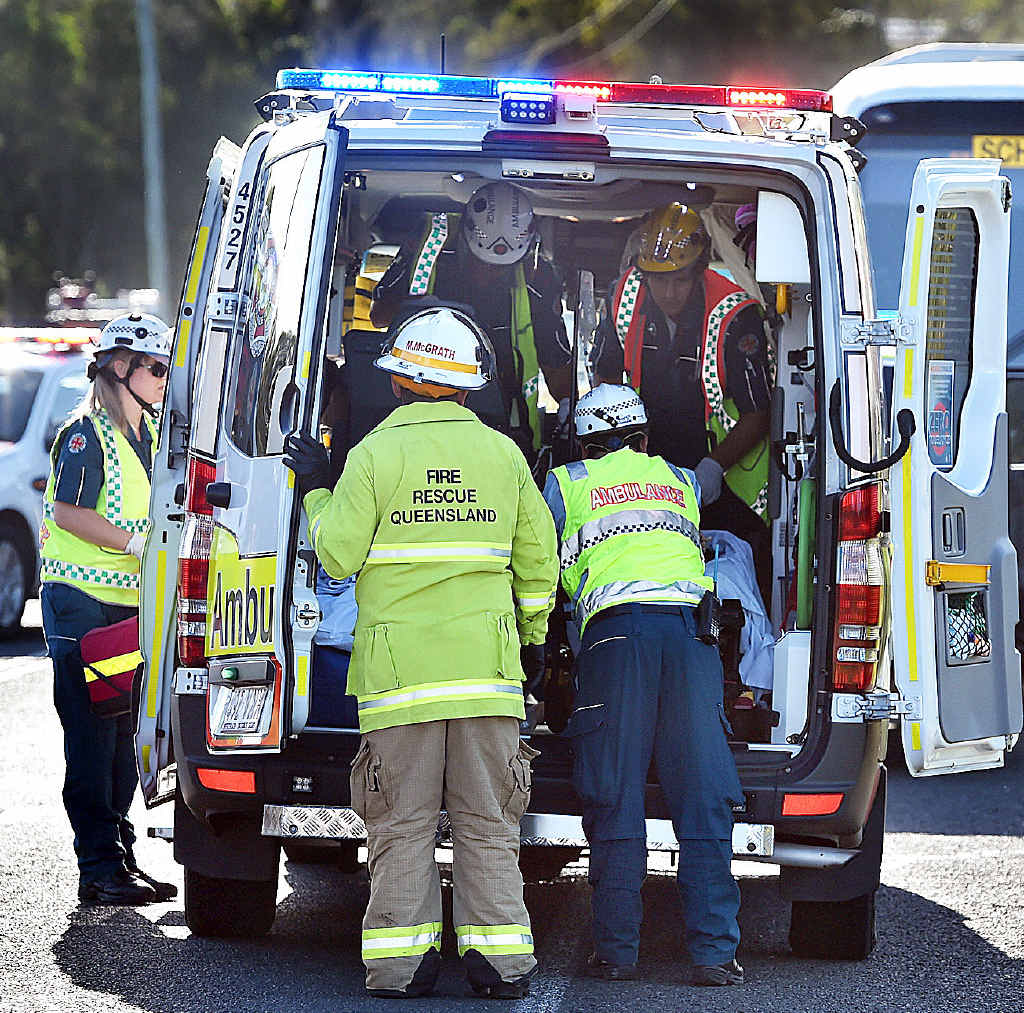 Bus and car crash at the intersection of Pialba-Burrum Heads Rd and Petersens Rd. A young patient is placed in the ambulance. Photo: Alistair Brightman / Fraser Coast Chronicle