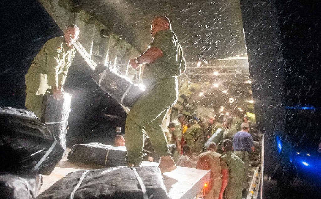 WELCOME HELP: Fijian soldiers unload aid supplies from a New Zealand C-130 Hercules in Suva.