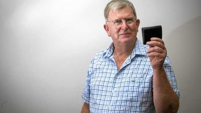 Andrew Baker of Maclean looks at a wallet after a Backward Glances report from The Daily Examiner 50 years ago recalled how he and a fellow Maclean High student found a wallet in the street gutter with more than $500 in it.