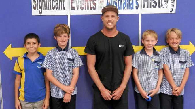 Mick Fanning pictured with excited Palmer's Island Public students last week.