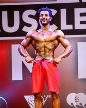 Jay Acharaya competing in the India Muscle Mania model category.