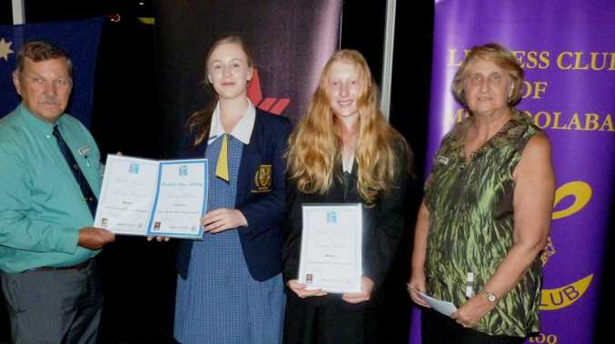 Lions Club President Ron Alexander presenting the award certificates to the two Youth of the Year students who will be representing Mooloolaba Lions and Lioness Clubs in the next stage of the program. Lauren Wilson (on the left) and Emma Hutton (on the right). On the far left is Mrs Stephanie Gear, the program co-ordinator from the Lions Club.