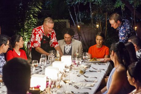 My Kitchen Rules contestants Mike and Tarq serve their entree during their instant restaurant in Cairns.