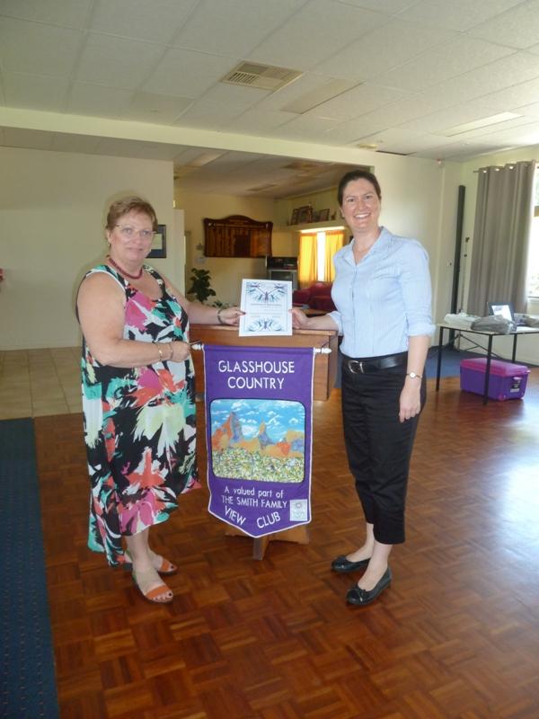 Lynda Flanagan presents Kathryn Rock with a certificate