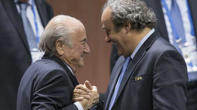 Outgoing .... FIFA president Sepp Blatter is greeted by UEFA President Michel Platini, right.