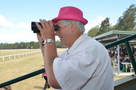 With an eye catching pink hat, Barry Green keeps a close eye on the race. Photo Barclay White / South Burnett Times