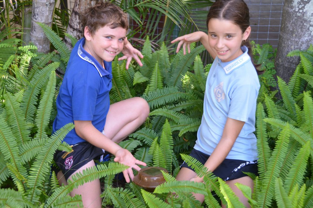 SAFETY FIRST: Gayndah State School students Kaenen Cooper and Lacey Johnson showcasing the snake repellent that has been working so well for their school. Photo Adam McCleery/ Central and North Burnett Times