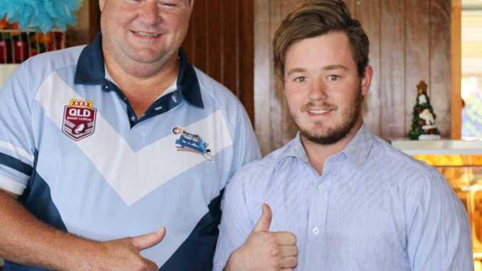 MOVED: CH rugby league president Frank Lambley presents Astin Nunan.