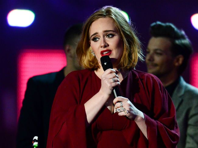 Adele took home four awards at the Brit Awards in London on Wednesday and broke down in tears while accepting the Global Success Award.