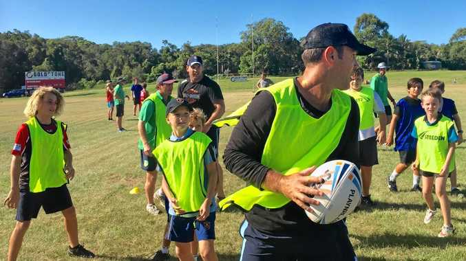 TRAINING: Members of the Byron Lennox Junior Rugby League Club putting Brad Fittler through is paces.