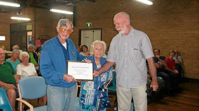 HONOURED: Bill Donsworth and his wife Doreen receive the Iluka Citizen of the Year award from Tony Belton.