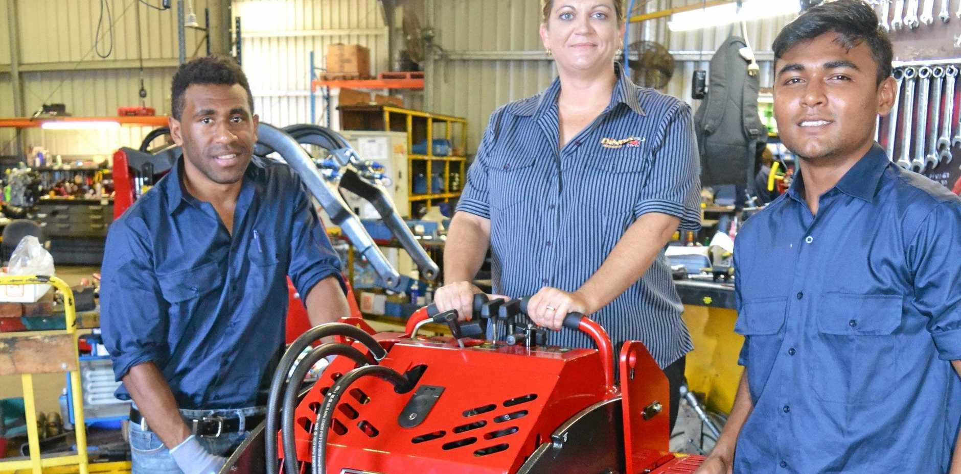 NEW START: Mike Gaur and Ashneel Dutt, pictured with HR manager Beth Morris on their first day of work at Dingo Australia in Dalby.