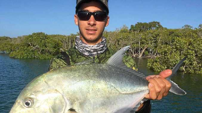 Dane Radosevic with a solid river golden trevally caught on a soft plastic, fished hard against a mangrove edge.