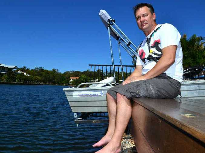 NO WAY: Mark Bowyer is the man who caught a bull shark in a Twin Waters canal about 12 months ago but says he is opposed to any council plan to relocate them.