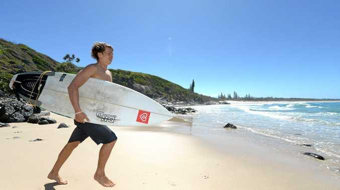 SURF'S UP: Local surfer Travis Coleman surveys the waves at Cabarita Beach.